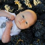 Baby on grapes